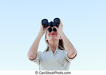 Businesswoman looking through binoculars - Young...