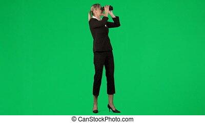 Businesswoman looking throught a binocular