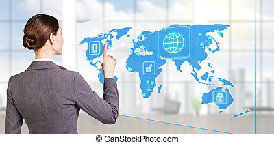 businesswoman looking to global business map