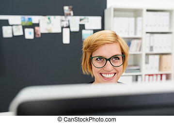 Businesswoman looking up with a beaming smile