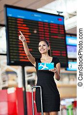 businesswoman, luchthaven, wijzende