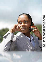 businesswoman making a call as she is lost