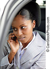 Businesswoman making a call from her car