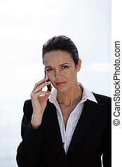Businesswoman making a call from outdoors