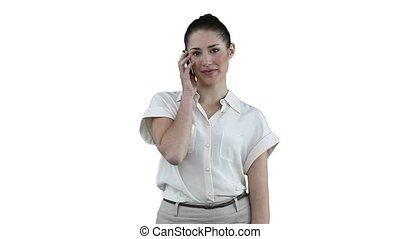 Businesswoman making a call while looking at the camera