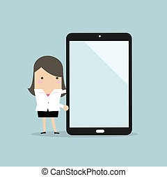 Businesswoman making a presentation on a large tablet or smartphone.