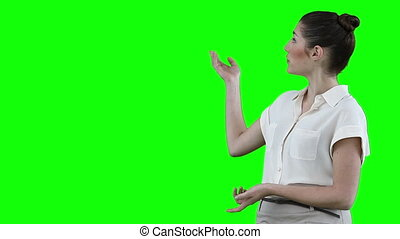 Businesswoman making a presentation with a virtual slideshow