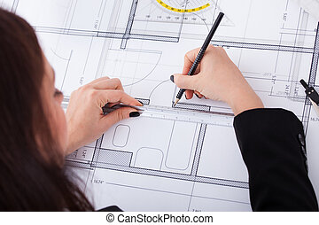 Businesswoman Making Blueprint