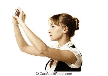 Businesswoman making photo shot