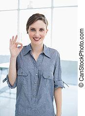 Businesswoman making positive gesture