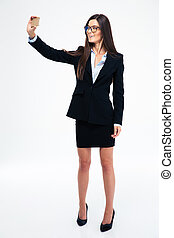 Businesswoman making selfie photo on smartphone