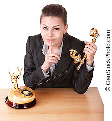 Businesswoman making silence gesture.