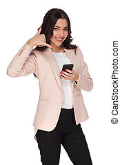 businesswoman making the call me sign while texting on phone