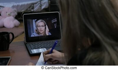 Businesswoman making video call to business partner using...