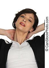 Businesswoman massaging her own neck