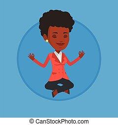 Businesswoman meditating in lotus position.
