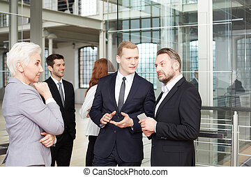 Businesswoman negotiating with business partners