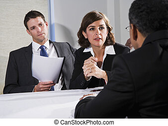 Businesswoman negotiating with men - Diverse business people...