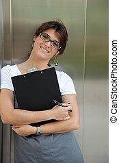 Businesswoman next to the elevator