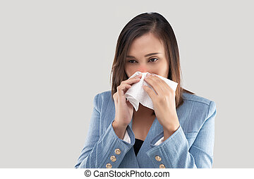 Businesswoman nose burning sensation because of the dust in the air