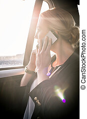 Businesswoman on call in car