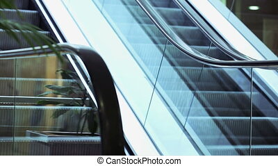 Businesswoman on escalator - Business woman coming down the...