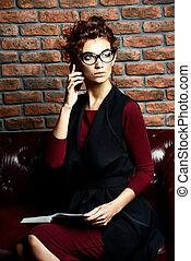 businesswoman on leather sofa
