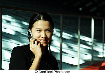 Businesswoman on the phone - A businesswoman talking on a...