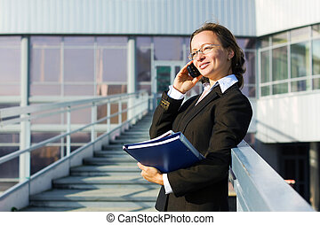 Businesswoman on the phone at airport