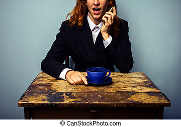 Businesswoman on the phone in coffee shop
