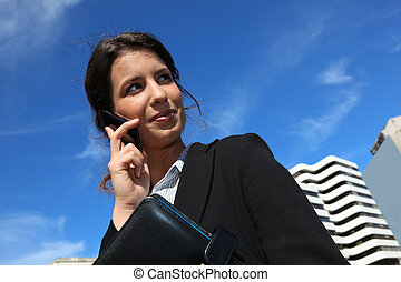 Businesswoman on the phone in the city