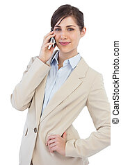 Businesswoman on the phone looking at camera