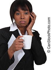 Businesswoman on the phone with a cup of tea