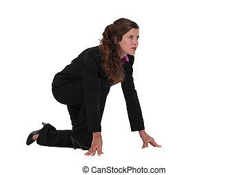 Businesswoman on the starting blocks