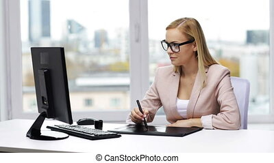 businesswoman or designer drawing with pen tablet