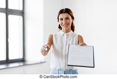 businesswoman or realtor showing contract document