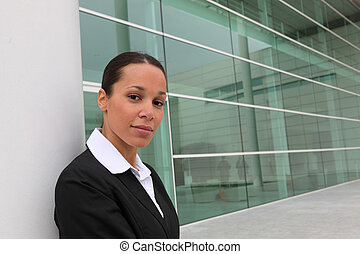 Businesswoman outside office block