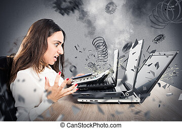 Businesswoman with worried expression with computer exploded