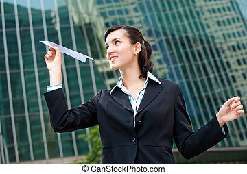 businesswoman, papieren vliegtuig