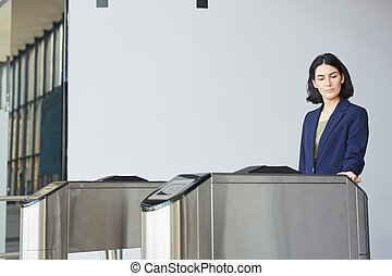 Businesswoman Passing Automatic Gate