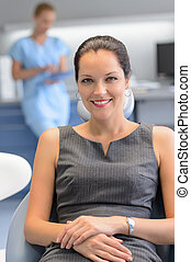Businesswoman patient at dental surgery checkup -...