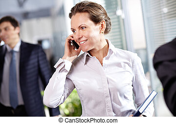Businesswoman phoning