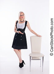 Businesswoman - The woman invites you to sit down on a chair...