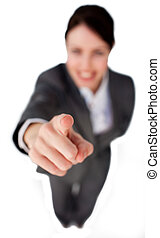 Businesswoman pointing at the camera against a white background