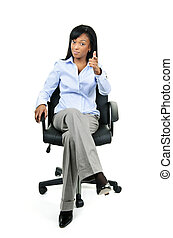Businesswoman pointing sitting on office chair