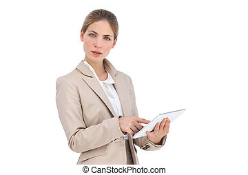 Businesswoman pointing something on her digital tablet