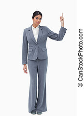 Businesswoman pointing upwards