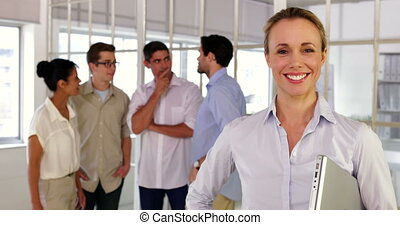 businesswoman posing in front of colleagues