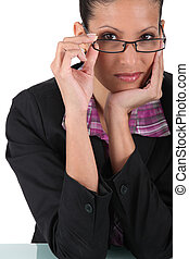 Businesswoman posing with glasses
