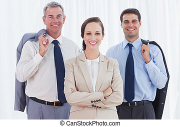 Businesswoman posing with her work team
